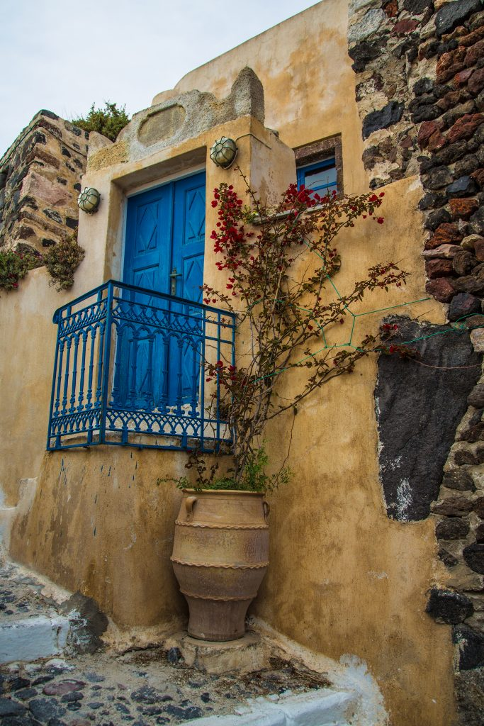 exterior-of-traditional-house-at-the-village-of-pyrgos-in-santorini-island-greece-683x1024